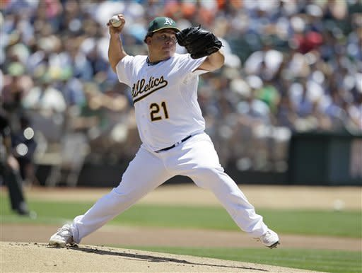 Oakland Athletics starting pitcher Bartolo Colon throws against the New York Yankees during the first inning of their baseball game Sunday, July 22, 2012 in Oakland, Calif. (AP Photo/Eric Risberg)