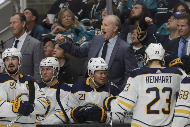 Buffalo Sabres head coach Ralph Krueger, center, reacts after official's ruled that Casey Mittelstadt scored a goal against the San Jose Sharks during the second period of an NHL hockey game in San Jose, Calif., Saturday, Oct. 19, 2019. (AP Photo/Jeff Chiu)