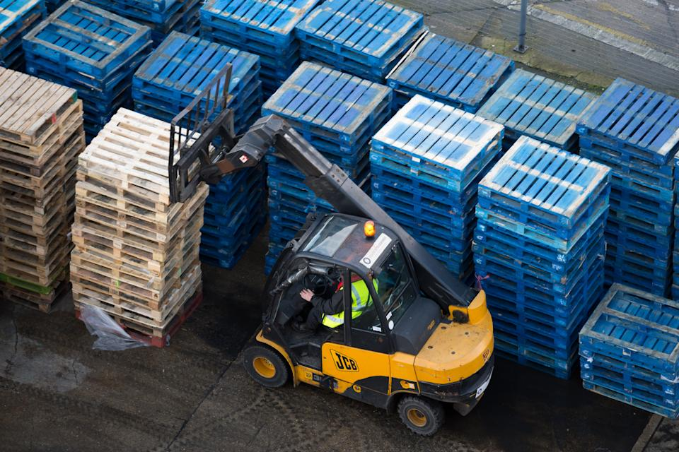 SOUTHAMPTON, ENGLAND - FEBRUARY 10: A forklift truck moves wooden pallets at the Port of Southampton on February 10, 2019 in Southampton, England. The Port of Southampton is a passenger and cargo port in the central part of the south coast of England. As the date for the UK's 2019 departure from the European Union approaches, uncertainty still remains regarding the future trading relationship and how this will affect exports and imports from ports such as Southampton. (Photo by Matthew Horwood/Getty Images)