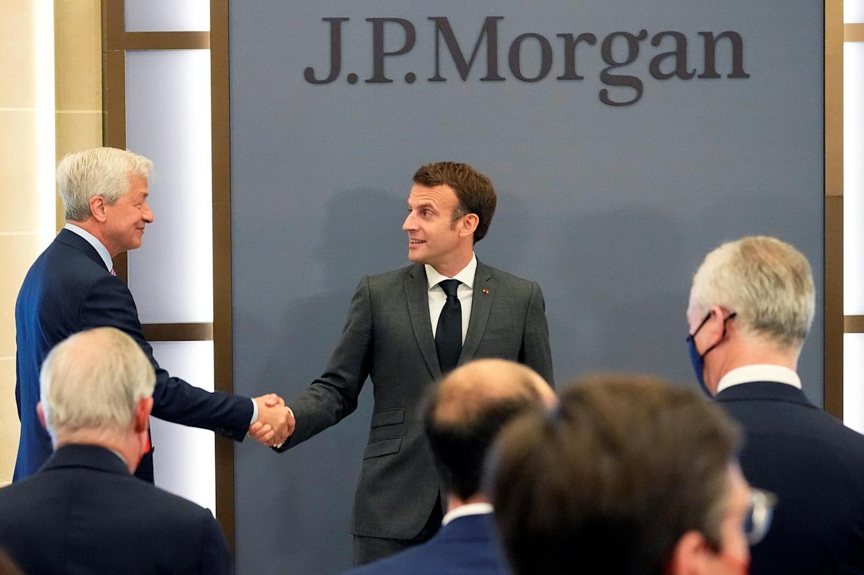 JP Morgan CEO Jamie Dimon (L) and French President Emmanuel Macron at the inauguration of the new French headquarters of JP Morgan. Photo: Reuters