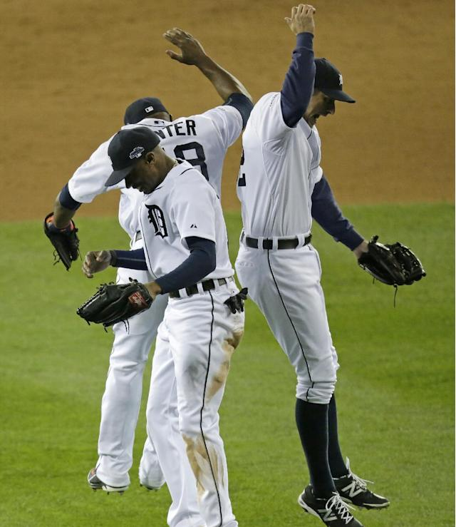 Detroit Tigers' Austin Jackson, Torii Hunter, and Don Kelly, right, celebrate after Game 4 of the American League baseball championship series against the Boston Red Sox, Wednesday, Oct. 16, 2013, in Detroit. The Tigers won 7-3. (AP Photo/Charlie Riedel)