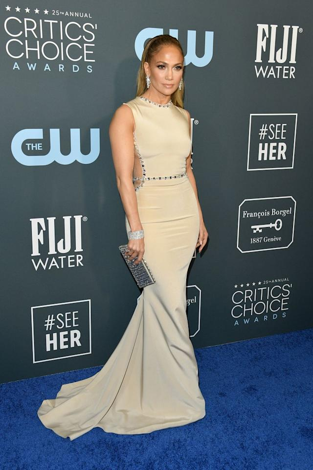 <p>J.Lo goes for a classy look in this neutral floor-length gown with side cutouts.</p>