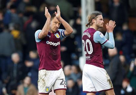 Soccer Football - Championship - Fulham vs Aston Villa - Craven Cottage, London, Britain - February 17, 2018 Aston Villa's John Terry and Stefan Johansen applaud the fans after the match Action Images/Paul Childs
