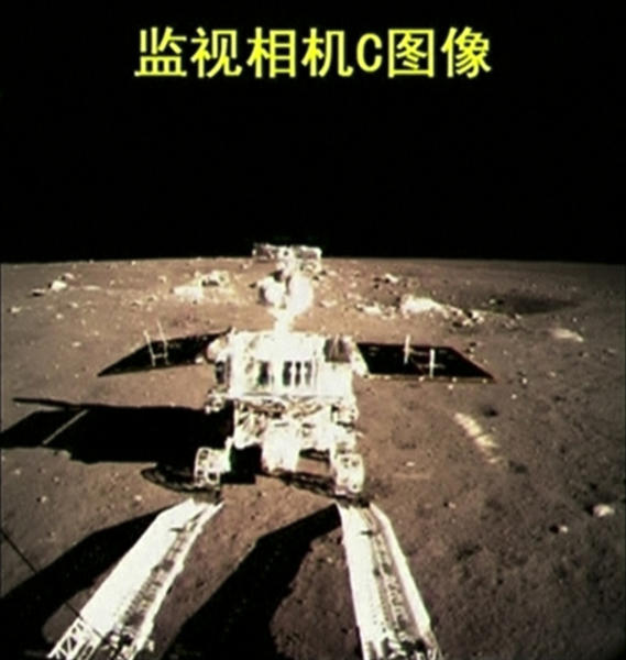 "This image taken from video, shows China's first moon rover touching the lunar surface and leaving deep traces on its loose soil on Sunday, Dec. 15, 2013, several hours after the country successfully carried out the world's first soft landing of a space probe on the moon in nearly four decades. The 300-pound ""Jade Rabbit"" rover separated from the much larger landing vehicle early Sunday, around seven hours after the unmanned Chang'e 3 space probe touched down on a fairly flat, Earth-facing part of the moon. The writing at the top of the image reads ""Surveillance camera C image."" (AP Photo/CCTV VNR via AP video)"