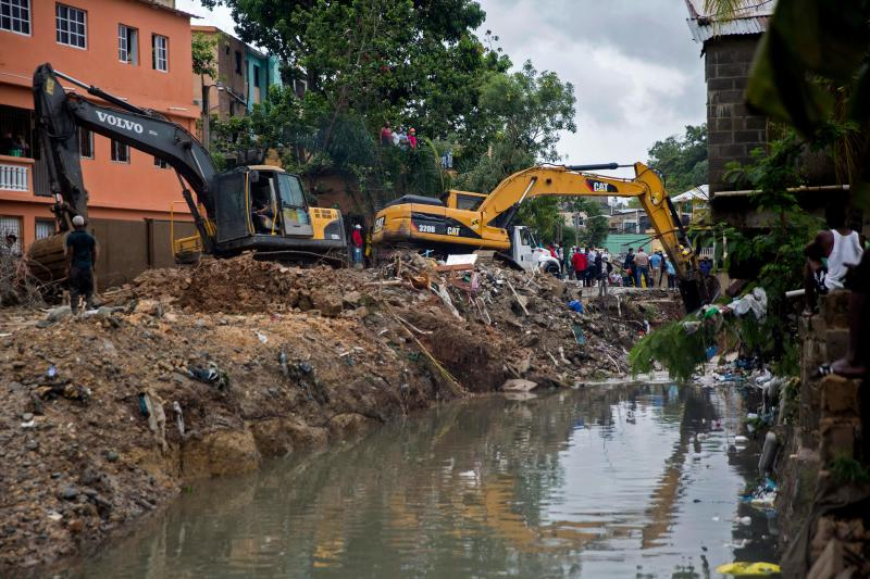 Backhoe machines work to remove debris after six small houses collapsed due to rains amid tropical storm Laura in Santo Domingo on August 23, 2020. - Tropical Storm Laura hammered Hispaniola island with heavy rain killing at least three people in the Dominican Republic and five in Haiti, and was set to become a hurricane on Tuesday. (Photo by Erika SANTELICES / AFP) (Photo by ERIKA SANTELICES/afp/AFP via Getty Images)
