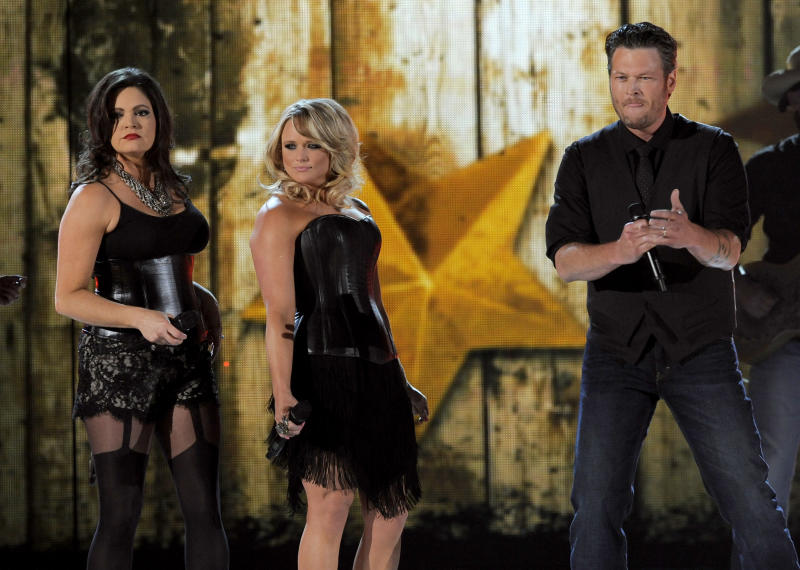 From left, Angaleena Presley and Miranda Lambert of musical group Pistol Annies, and singer Blake Shelton perform at the 48th Annual Academy of Country Music Awards at the MGM Grand Garden Arena in Las Vegas on Sunday, April 7, 2013. (Photo by Chris Pizzello/Invision/AP)