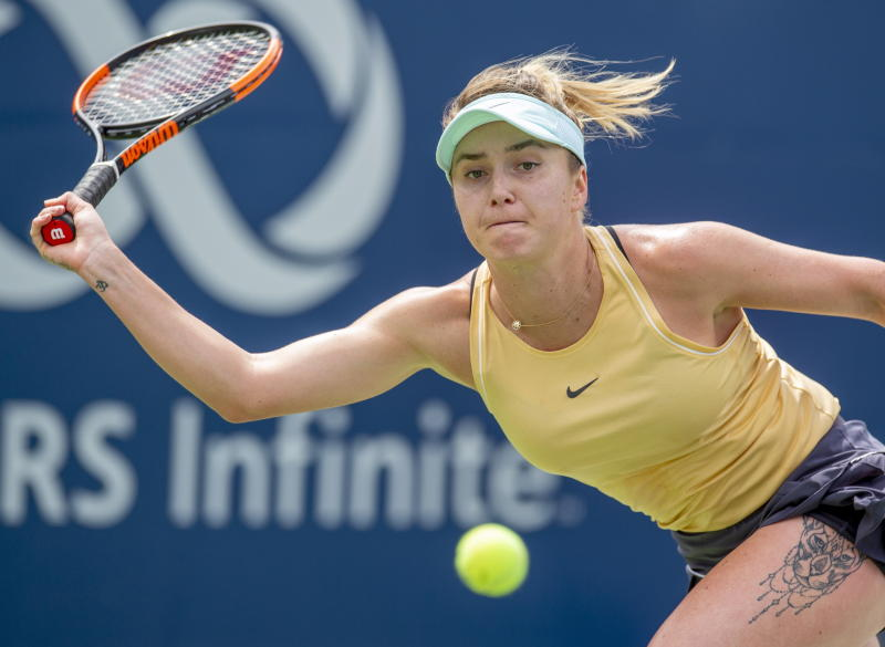 Elina Svitolina, of Ukraine, runs down a forehand against Sofia Kenin in a quarterfinal match at the Rogers Cup tennis tournament in Toronto, Friday Aug. 9, 2019. (Frank Gunn/The Canadian Press via AP)