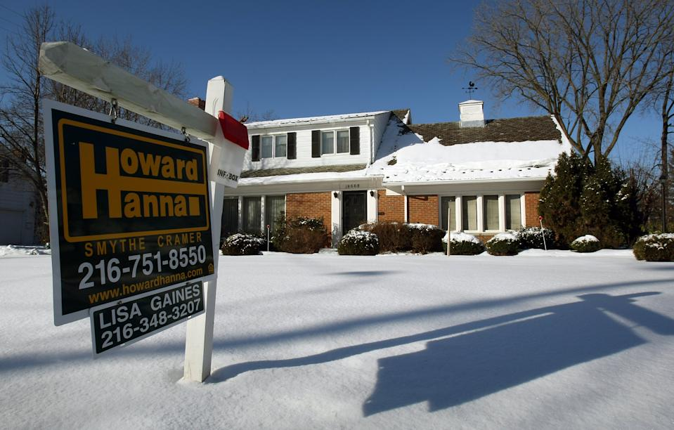 A sale sign sits in front of a home in the Shaker Heights section of Cleveland, Ohio, 25 January 2008. The area is filled with homes for sale or on the auction block. The city of Cleveland is the epicenter of the nation's home foreclosure crisis and is creating bad news for nearby homeowners and cities across the country because they lead to falling property values and increased crime.  AFP PHOTO/Timothy A. CLARY (Photo by Timothy A. CLARY / AFP) (Photo by TIMOTHY A. CLARY/AFP via Getty Images)