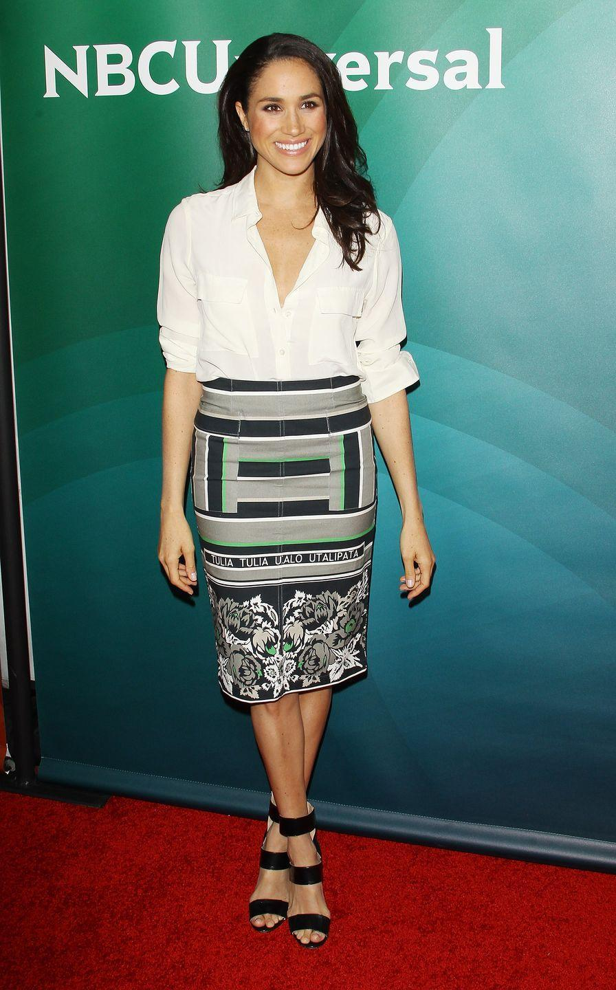 <p>Meghan, like Kate, offset the patterned skirt she wore during a press tour in 2014 with a simple white blouse and black shoes. An extremely chic ensemble, if you ask me. </p>