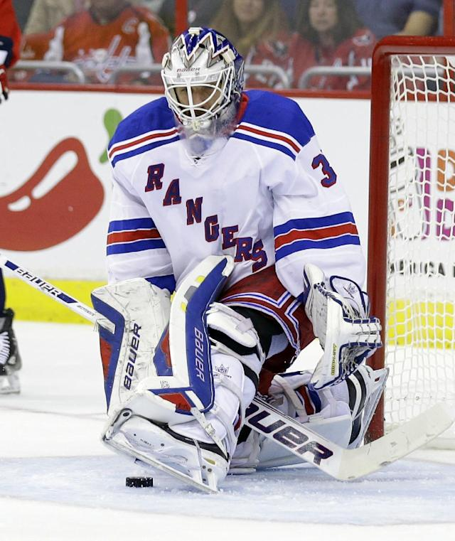 New York Rangers goalie Henrik Lundqvist, from Sweden, uses his skate to block a shot in the first period of an NHL hockey game against the Washington Capitals, Wednesday, Oct. 16, 2013, in Washington. The Rangers won 2-0. (AP Photo/Alex Brandon)