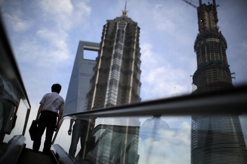 A man rides an escalator at the Pudong financial district in Shanghai