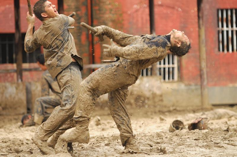 "This image released by Sony Pictures Classics shows Iko Uwais as Rama, left, in a scene from The Raid 2."" (AP Photo/Sony Pictures Classics)"