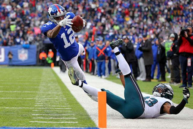 <p>New York Giants wide receiver Tavarres King (12) runs for a touchdown against Philadelphia Eagles safety Rodney McLeod (23) during the third quarter at MetLife Stadium. Mandatory Credit: Brad Penner-USA TODAY Sports </p>
