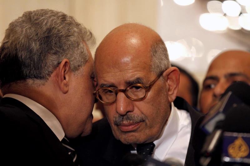 In this Thursday, Nov. 22, 2012 photo, former Egyptian presidential candidate, Hamdeen Sabahi, left, speaks to former director of the U.N.'s nuclear agency and Nobel peace laureate, Mohamed El Baradei, during a news conference flanked by other prominent politicians, not shown, from outside the Muslim Brotherhood, to decry what was interpreted as a de facto declaration of emergency law by Egyptian President Mohammed Morsi, in Cairo Egypt. Egypt's Islamist president unilaterally decreed greater authorities for himself Thursday and effectively neutralized a judicial system that had emerged as a key opponent by declaring that the courts are barred from challenging his decisions. (AP Photo/Mostafa El Shemy)