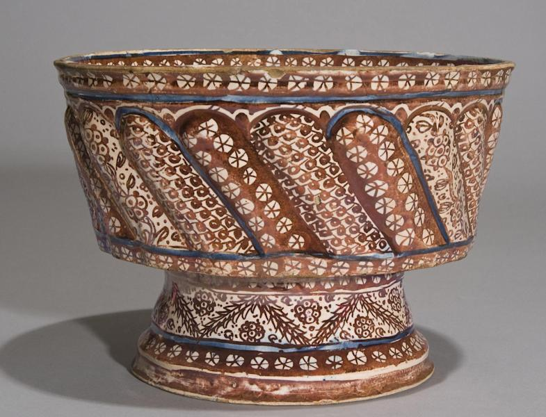 """In this 2008 photo provided by the Museum of Arts and Design, a footed basin from Spain that dates back to the early 16th Century is shown. The basin is among the artifacts from the estate of the of the late philanthropist and art collector Doris Duke that are featured in an exhibit entitled """"Doris Duke's Shangri La: Architecture, Landscape and Islamic Art,"""" at the Museum of Arts and Design in New York. The exhibit runs through Jan. 6, 2013. (AP Photo/Museum of Arts and Design, Doris Duke Foundation for Islamic Art, David Franzen)"""