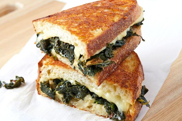 """<p>This is the savory grilled cheese you love, but packed with good-for-you greens. </p><p><strong><em>Get the recipe at <a href=""""https://www.delish.com/cooking/recipe-ideas/a35702269/kale-grilled-cheese-recipe/"""" rel=""""nofollow noopener"""" target=""""_blank"""" data-ylk=""""slk:Delish."""" class=""""link rapid-noclick-resp"""">Delish.</a></em></strong></p>"""