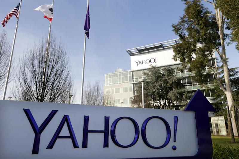 FILE - This Jan. 14, 2015, file photo shows a sign outside Yahoo's headquarters in Sunnyvale, Calif. In an indictment Wednesday, March 15, 2017, announcing charges against four Russians, U.S. officials describe how Russian hackers working with Russian intelligence officials broke into Yahoo's network, stole information on Yahoo user accounts and ultimately gained entry into other services used by individuals they were targeting. (AP Photo/Marcio Jose Sanchez, File)