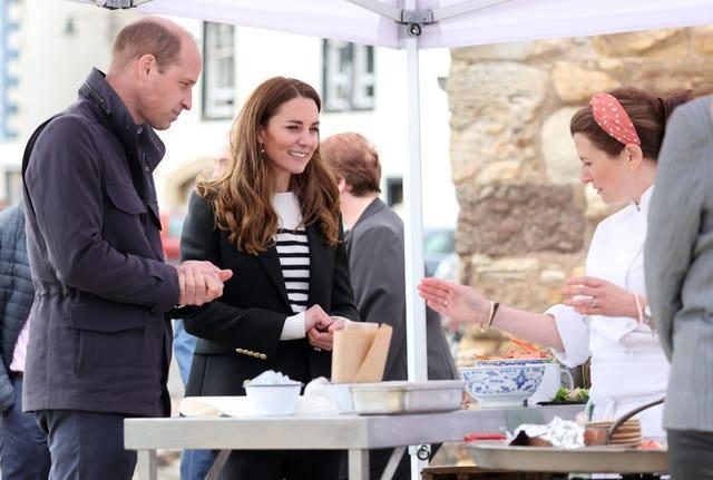 The Duke and Duchess of Cambridge look at local produce after meeting fishing families (Chris Jackson/PA)