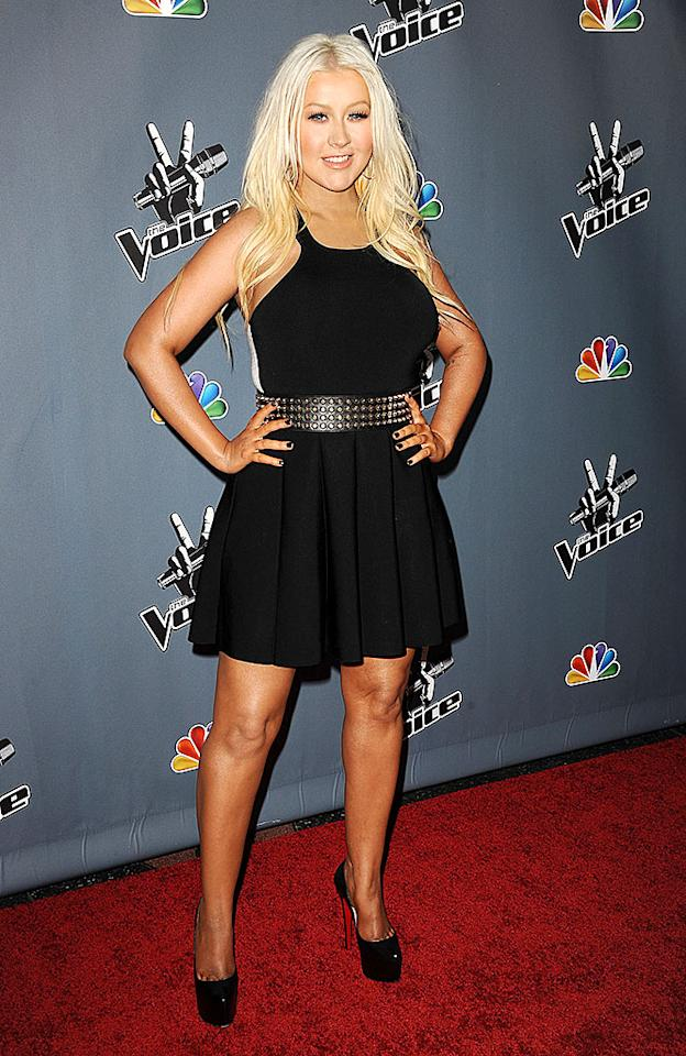 "Look which former ""Dirrty"" girl has cleaned up her act (and lost a few dress sizes)! It's none other than Christina Aguilera, who looked better than she has in years at the Season 4 premiere of ""The Voice"" in Hollywood on Wednesday evening. A face free of clown makeup and a sensible-yet-stylish LBD are working wonders for the former Mouseketeer ... as are those sky-high Louboutins! (3/20/2013)"