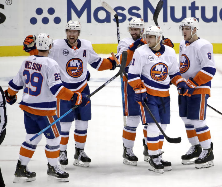 New York Islanders' Josh Bailey (12) celebrates his empty-net goal against the Pittsburgh Penguins during the third period in Game 4 of an NHL hockey first-round playoff series in Pittsburgh, Tuesday, April 16, 2019. The Islanders won 3-1, sweeping the series. (AP Photo/Gene J. Puskar)