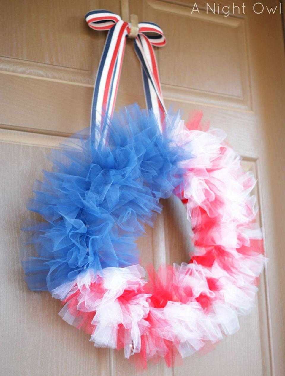 """<p>Enlist your kids to help tie strips of tulle around this wreath to make this patriotic decoration.</p><p><strong>Get the tutorial at <a href=""""https://www.anightowlblog.com/thrifty-thursday-a-memorial-day-tulle-flag-wreath-2/"""" rel=""""nofollow noopener"""" target=""""_blank"""" data-ylk=""""slk:A Night Owl"""" class=""""link rapid-noclick-resp"""">A Night Owl</a>.</strong></p><p><strong><a class=""""link rapid-noclick-resp"""" href=""""https://www.amazon.com/Supla-Rainbow-Netting-Scissors-Measuring/dp/B07D74YLGS/ref=sr_1_5?tag=syn-yahoo-20&ascsubtag=%5Bartid%7C10050.g.4464%5Bsrc%7Cyahoo-us"""" rel=""""nofollow noopener"""" target=""""_blank"""" data-ylk=""""slk:SHOP TULLE RIBBON"""">SHOP TULLE RIBBON </a></strong></p>"""