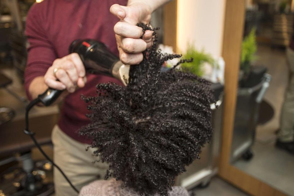 <p>The next step to getting the big hair of your natural dreams is to stretch it with a blow dryer. Focus the heat at your roots while pulling hair from the mid-shaft. In order to prevent frizz, however, try to avoid combing hair with your fingers.</p>