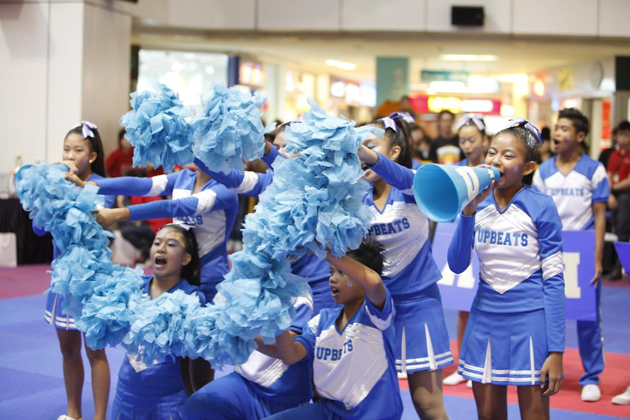 Westwood Secondary Students put up a happy face for the judges in the midst of their cheerleading routine.