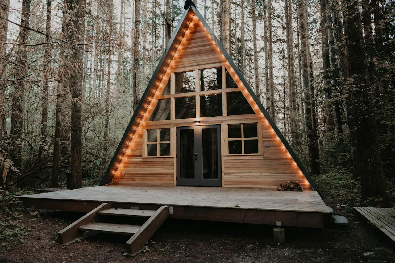 """<p><a href=""""https://www.cntraveler.com/gallery/a-frame-cabins-to-rent-on-airbnb?mbid=synd_yahoo_rss"""" target=""""_blank"""">We love a good A-frame</a> and this one-bedroom delivers on that <a href=""""https://www.cntraveler.com/galleries/2015-11-23/20-places-that-are-straight-out-of-fairy-tales?mbid=synd_yahoo_rss"""" target=""""_blank"""">romantic fairy tale</a> cabin feel. Outside, a deck outlined in string lights and a hot tub draw you in, while the remote-controlled gas fireplace, Smart TV, and stacks of board games will keep you entertained inside. Lots of professional photographers and Instagrammers have spent the night here (<a href=""""https://www.cntraveler.com/story/what-i-learned-from-full-time-traveland-why-i-stopped-women-who-travel-podcast?mbid=synd_yahoo_rss"""" target=""""_blank"""">Women Who Travel podcast guest Renee Hahnel</a> is featured in the listing), so you know the photos from your weekend away are sure to impress. Its location in Skykomish, near Stevens Pass and Leavenworth ski resorts, mean you can escape the cabin for some outdoor activity if you need a break from the one-on-one time.</p> <p><strong>Book Now:</strong> <a href=""""https://airbnb.pvxt.net/ZGr0k"""" rel=""""nofollow"""" target=""""_blank"""">From $220 per night, airbnb.com</a></p>"""