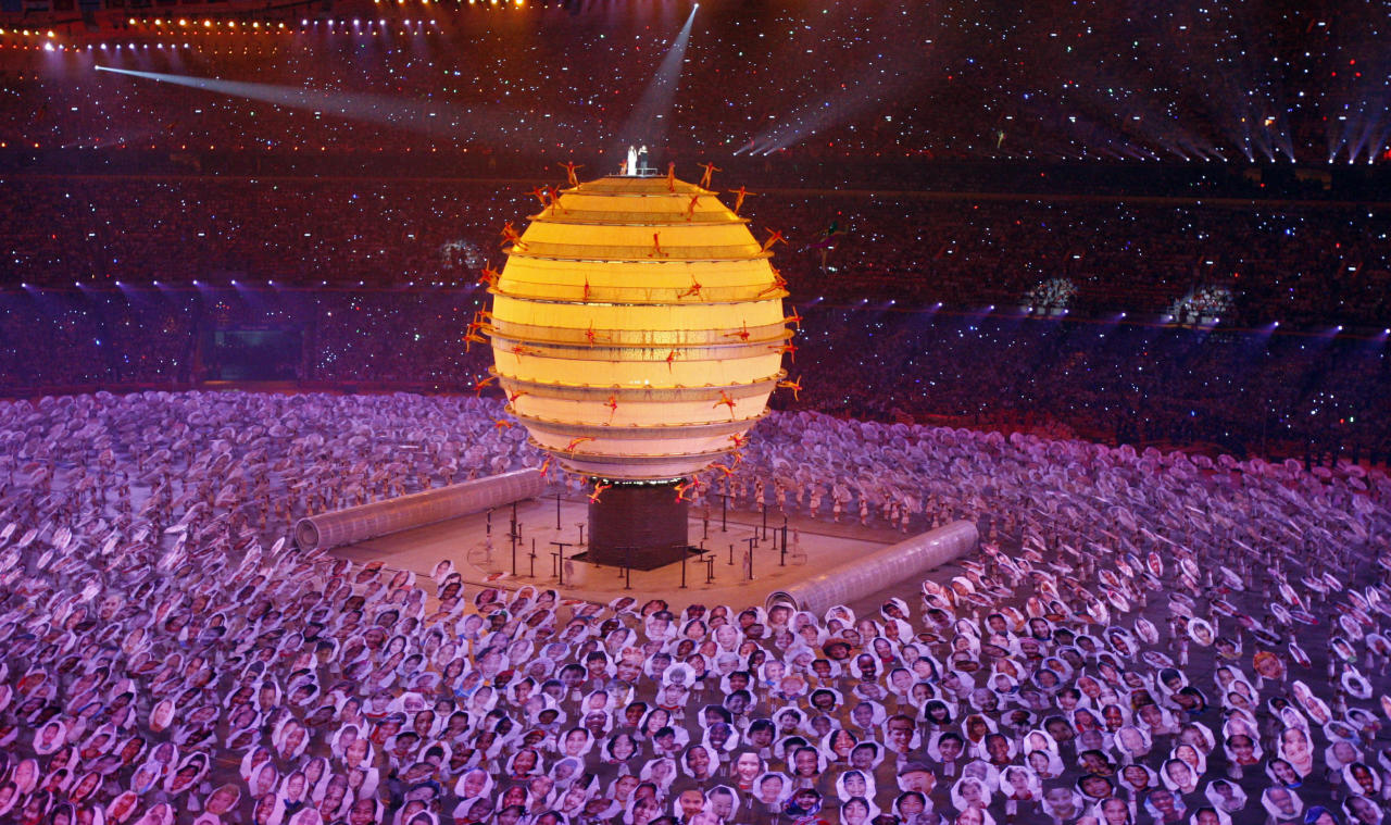 Performers dance around a raised sphere during the opening ceremony for the Beijing 2008 Olympics in Beijing, Friday, Aug. 8, 2008. (AP Photo/Luca Bruno)