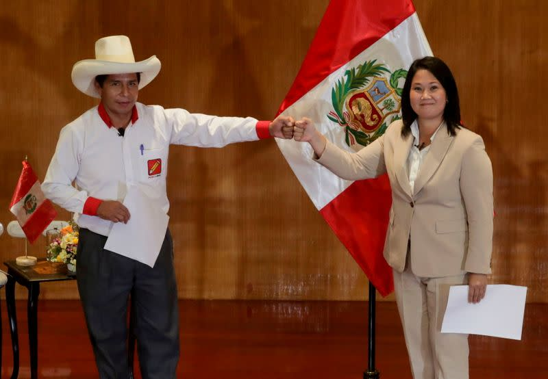FILE PHOTO: Peruvian presidential candidates Pedro Castillo and Keiko Fujimori, who will face each other in a run-off vote on June 6, gesture, in Lima