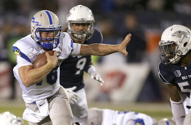 Air Force's Karson Roberts (16) runs through the Nevada defense during the second half of an NCAA college football game in Reno, Nev., on Saturday, Sept. 28, 2013. (AP Photo/Cathleen Allison)