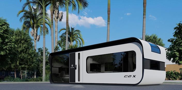the exterior of the one-bedroom Cube Two X around palm trees