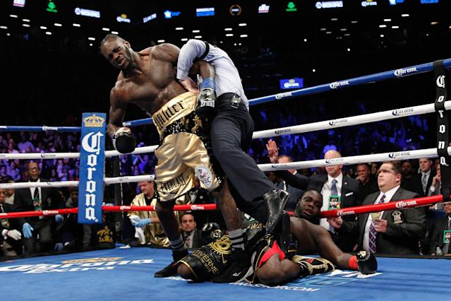 WBC heavyweight champion Deontay Wilder, shown knocking out Bermane Stiverne in November, is confident a bout with IBF-WBA champion Anthony Joshua will occur in 2018. (Getty Images)