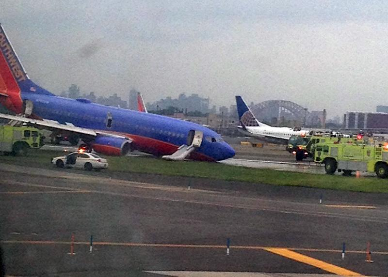NYC airport fully reopens after jet's hard landing