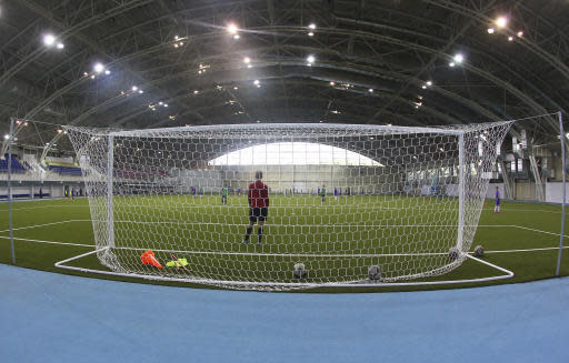 This photo taken on Thursday, May 17, 2018, shows an indoor soccer pitch at the Olympic Sports Center in Saransk, Russia. Russia is trying to wipe its sports reputation clean by hosting the World Cup after years of doping scandals. In the host city of Saransk, a training center notorious for doping abuses and tainted medals will now be the home of Panamas soccer team. (AP Photo/Julia Chestnova)