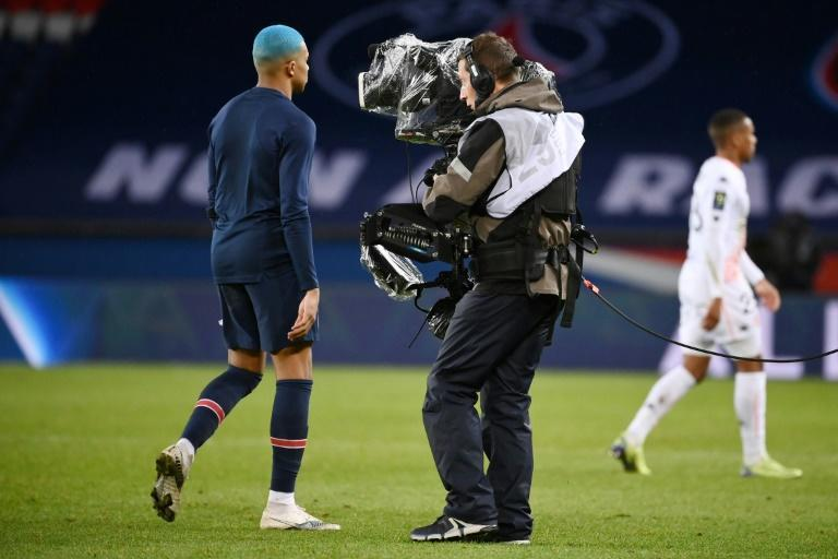 PSG superstar Kylian Mbappe walks past the camera -- the French league is hoping to agree a new domestic broadcast deal next week after the disastrous collapse of its record contract with Mediapro