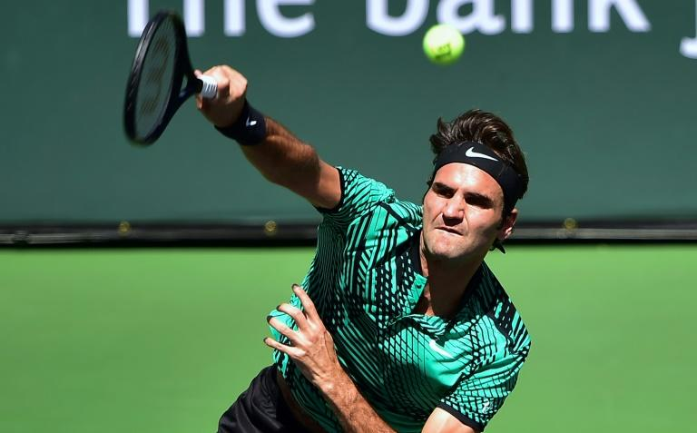 Roger Federer of Switzerland serves to Jack Sock of the US in their men's semifinal at the ATP Indian Wells Masters in Indian Wells, California on March 18, 2017
