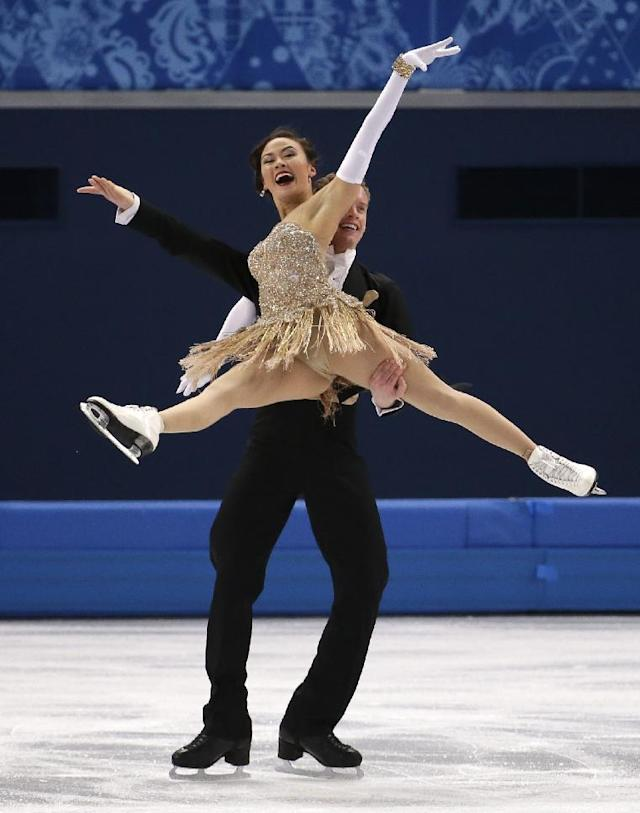 Madison Chock and Evan Bates of the United States compete in the ice dance short dance figure skating competition at the Iceberg Skating Palace during the 2014 Winter Olympics, Sunday, Feb. 16, 2014, in Sochi, Russia. (AP Photo/Bernat Armangue)