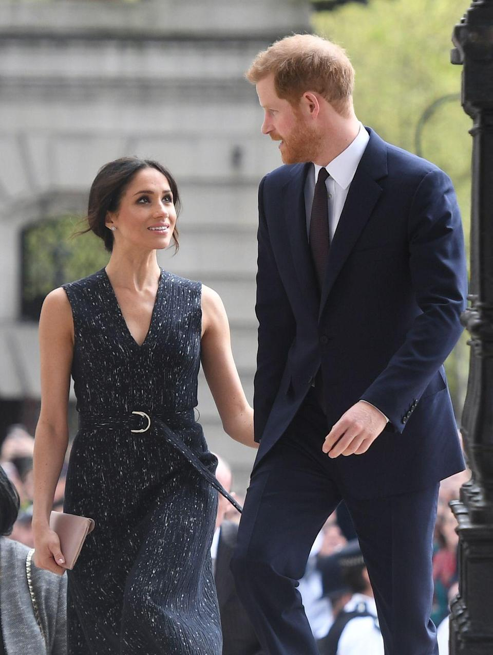 <p>Markle looked up to her husband-to-be with admiration and love as they attended a memorial service to commemorate the 25th anniversary of the murder of Stephen Lawrence in April 2018. </p>