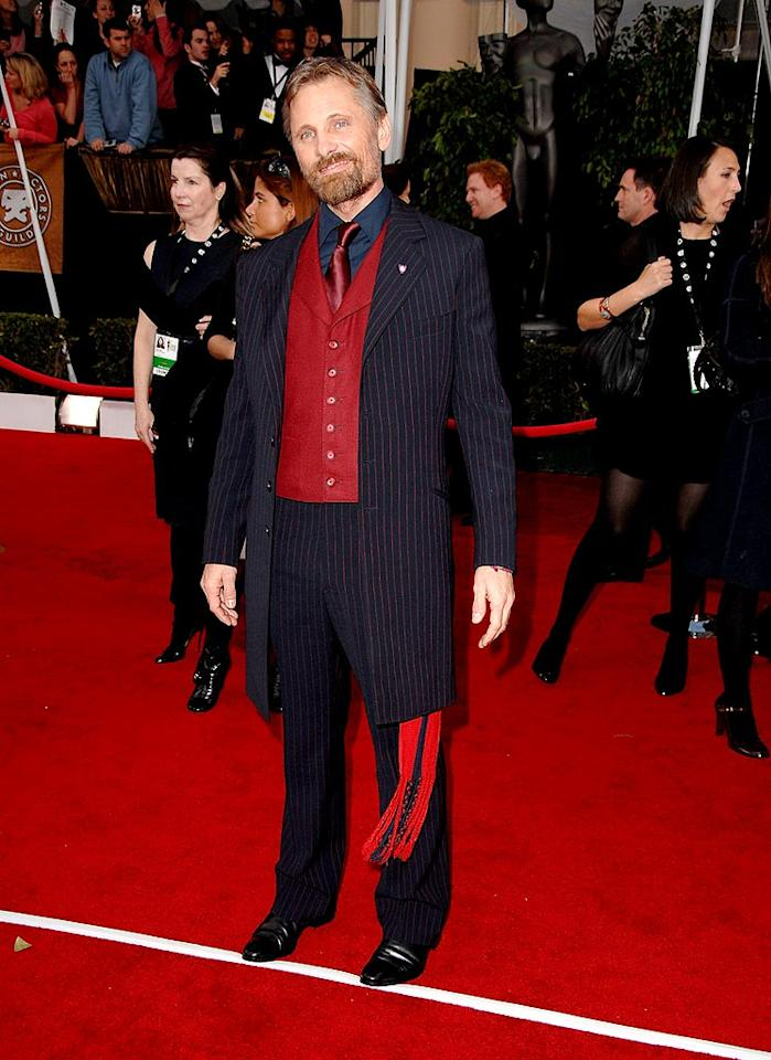 "Viggo Mortensen shows his support for the Argentinian soccer team in a very loud red and blue pinstriped suit . Steve Granitz/<a href=""http://www.wireimage.com"" target=""new"">WireImage.com</a> - January 27, 2008"