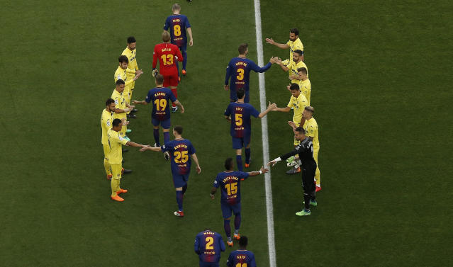 Villarreal players form a passage of honor for FC Barcelona players prior the Spanish League soccer match between FC Barcelona and Villarreal at the Camp Nou stadium in Barcelona, Spain, Wednesday, May 9, 2018. FC Barcelona won their 25th Spanish League title. (AP Photo/Manu Fernandez)