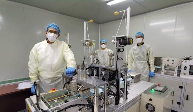 Edwin Cheng and his team on the production line that will aim to produce 12 million masks. Photo: Handout