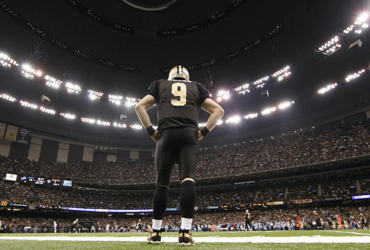 FILE - In this Jan. 7, 2012, file photo, New Orleans Saints quarterback Drew Brees (9) watches from the sidelines during the first half of an NFL wild card playoff football game against the Detroit Lions in New Orleans. Brees has agreed to a five-year, $100 million contract with the Saints, with $60 million guaranteed, on Friday, July 13, 2012, a person familiar with the deal tells The Associated Press. (AP Photo/Gerald Herbert, File)