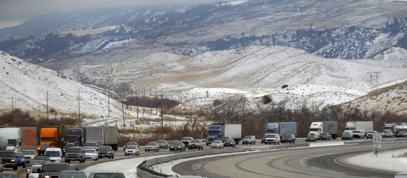 Closed I-5 northbound lanes are shown empty of traffic due to snow and ice Friday Jan. 11, 2013 near Gorman, Calif. California authorities on Friday reopened this 40-mile stretch of a major highway north of Los Angeles, some 17 hours after snow shut the route and forced hundreds of truckers to spend the cold night in their rigs.(AP Photo/Nick Ut)