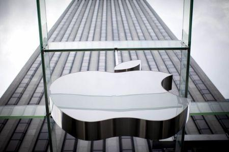An Apple logo hangs above the entrance to the Apple store on 5th Avenue in New York City, in this file photo taken July 21, 2015. The U.S. Supreme Court on Monday declined to hear Apple Inc's challenge to an appellate court decision that it conspired with five publishers to increase e-book prices, meaning it will have to pay $450 million as part of a settlement.   REUTERS/Mike Segar/Files