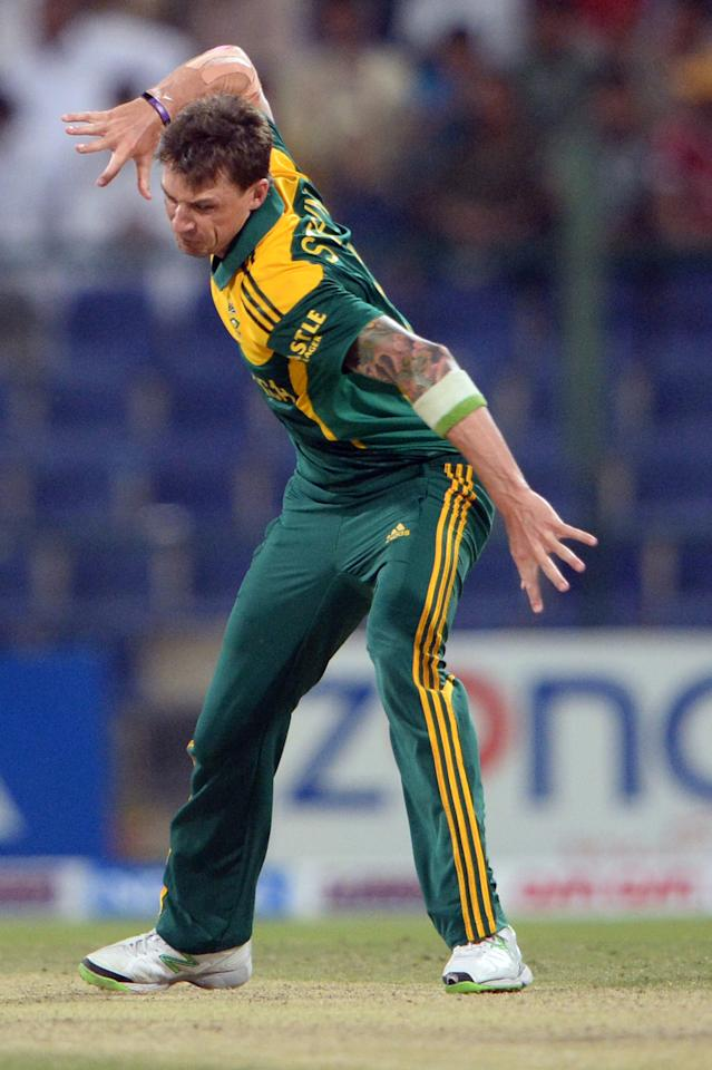 South African bowler Dale Steyn  celebrates after clean bowled of Pakistani cricketer Saeed Ajmal (unseen) during the fourth day-night international in Sheikh Zayed Cricket Stadium in Abu Dhabi on November 8, 2013. South Africa beat Pakistan by 28 runs, to take an unbeatable 3-1 lead in the five-match series. AFP PHOTO/ ASIF HASSAN        (Photo credit should read ASIF HASSAN/AFP/Getty Images)