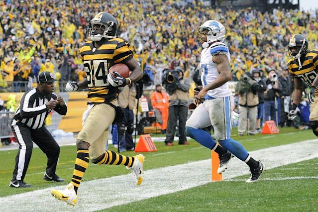 Pittsburgh Steelers wide receiver Antonio Brown (84) gets into the end zone ahead of Detroit Lions strong safety Glover Quin (27) for a touchdown in the first half of an NFL football game on Sunday, Nov. 17, 2013, in Pittsburgh. (AP Photo/Don Wright)