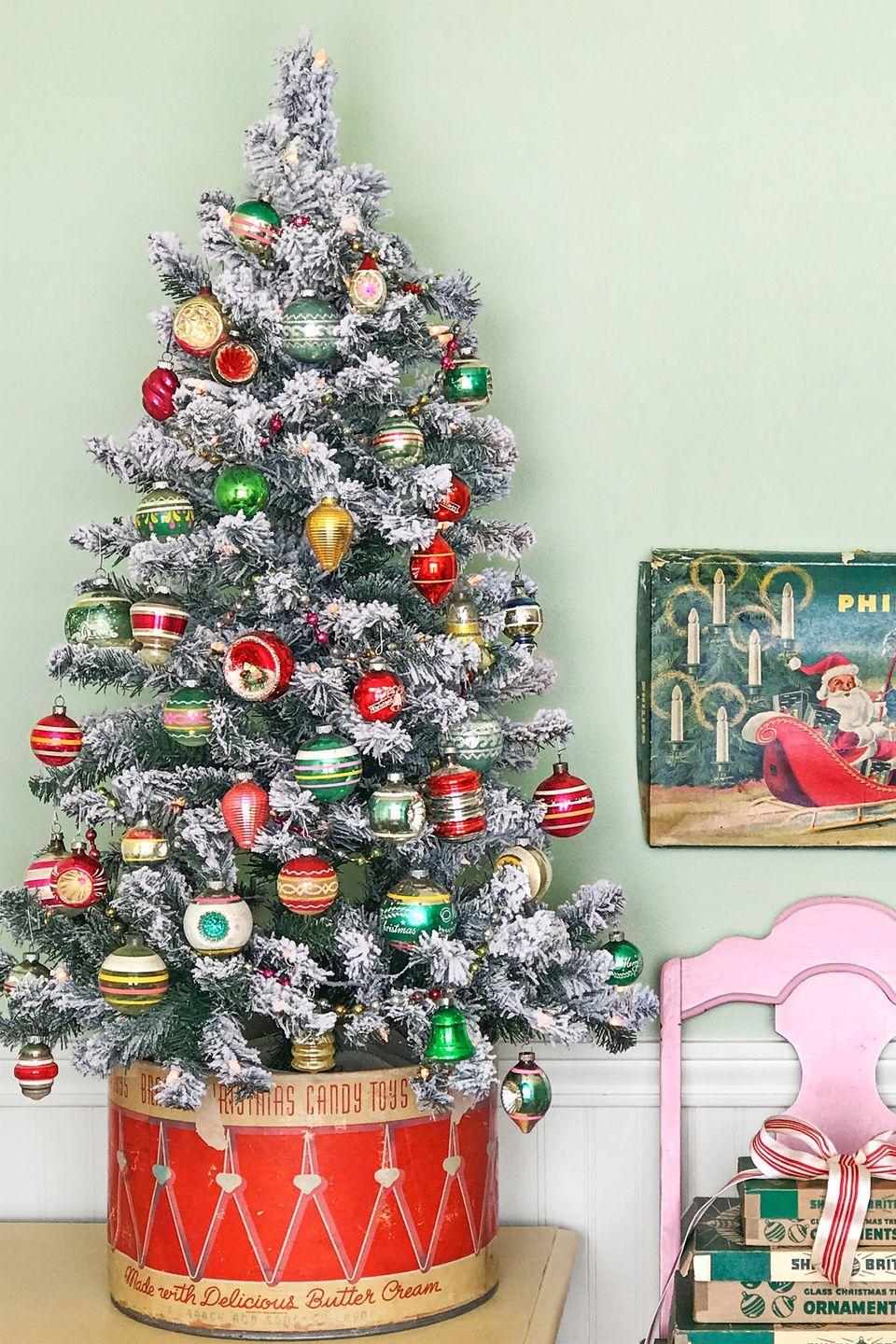 """<p>Cover the unsightly base of an artificial Christmas tree by placing it in an antique candy box or toy chest. </p><p><strong>RELATED: </strong><a href=""""https://www.countryliving.com/home-design/decorating-ideas/tips/g1251/trim-christmas-trees-1208/"""" rel=""""nofollow noopener"""" target=""""_blank"""" data-ylk=""""slk:Beautiful Ideas to Trim Your Tree This Holiday Season"""" class=""""link rapid-noclick-resp"""">Beautiful Ideas to Trim Your Tree This Holiday Season</a></p>"""