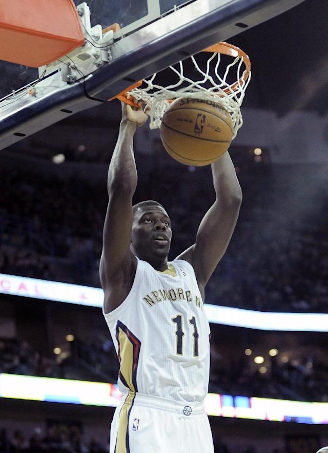 New Orleans Pelicans guard Jrue Holiday (11) scores against the Denver Nuggets in the second half of an NBA basketball game in New Orleans, Friday, Dec. 27, 2013. New Orleans won 105-89. (AP Photo/Stacy Revere)