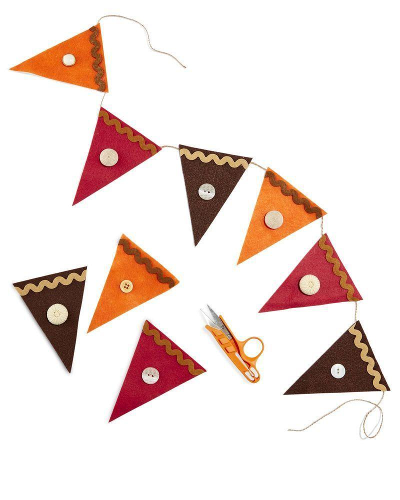 """<p>Decorate the dining room with this easy-as-pie craft.</p><p><strong>Make the Garland:</strong> Cut triangles from brown, orange, and burgundy felt. Attach a length of rickrack with hot-glue to create the """"crust."""" Add a button """"dollop"""" in the center of the triangle with hot-glue. Attach twine to the backs with hot-glue for hanging.</p><p><a class=""""link rapid-noclick-resp"""" href=""""https://www.amazon.com/flic-flac-inches-Assorted-Fabric-Patchwork/dp/B01GCRXBVE/ref=sr_1_1_sspa?tag=syn-yahoo-20&ascsubtag=%5Bartid%7C10050.g.2063%5Bsrc%7Cyahoo-us"""" rel=""""nofollow noopener"""" target=""""_blank"""" data-ylk=""""slk:SHOP FELT"""">SHOP FELT</a></p>"""